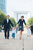 Family of four walking to city — Stock Photo