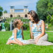 Cute girl and her mother in the summer park — Stock Photo