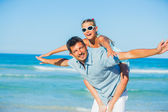 Father and his daughter having fun on beach — Stock Photo