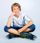 Portrait of young beautiful boy roller skating — Stock Photo