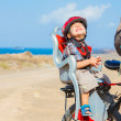 Child sitting by bicycle in crash helmet — Stock Photo #9686768
