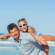 Father and his daughter having fun on beach — Stock Photo #9698840