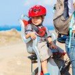 Child sitting by bicycle in crash helmet — Stock Photo #9698967