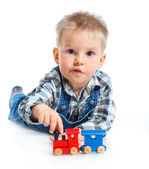 Cute little boy playing trains — Stock Photo