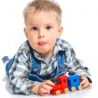 Stock Photo: Cute little boy playing trains