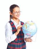 Schoolgirl with a globe — Stock Photo