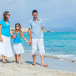 Family having fun on tropical beach — Stock Photo #9838409