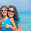Mother and her daughter having fun on beach — Stock Photo #9838435