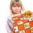Portrait of happy little girl with gift box — Stock Photo