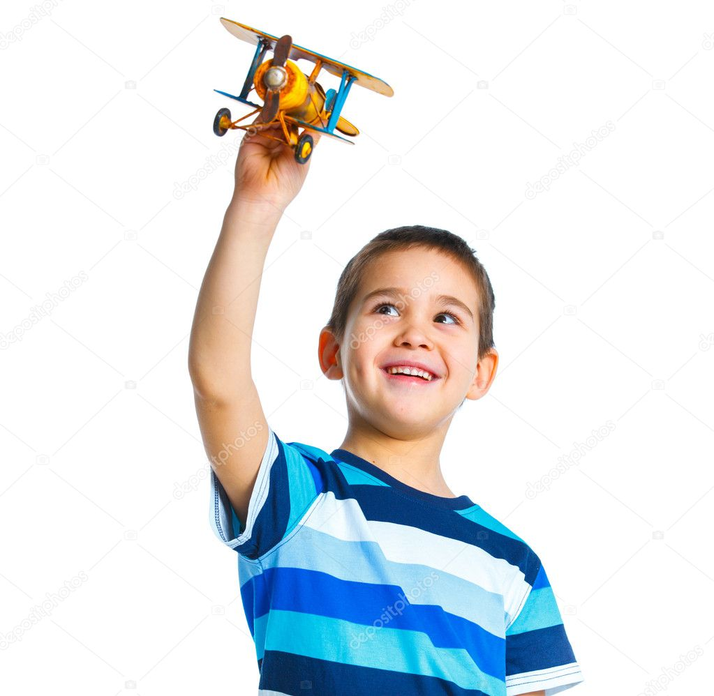 Cute little boy playing with a toy airplane. Isolated on white background  Stock Photo #9861105