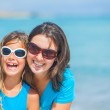Mother and her daughter having fun on beach — Stock Photo #9967480
