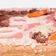 Sand cake with pink icing, candied fruit and cream — Stock Photo