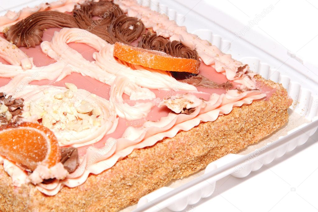 Sand cake with pink icing, nuts, candied fruit and cream  Stock Photo #8986441