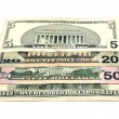 Stock Photo: Miscellaneous denominations of dollars