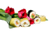 Red flowers and vegetable rolls — Stock Photo