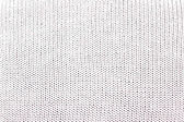 White knitted background with holes and impregnations — Stock Photo
