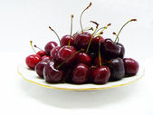 Sweet cherries on plate — Stock Photo