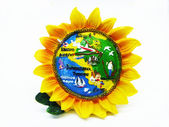 Souvenir in the manner of sunflower on white background — Stock Photo