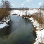 Winter landscape of the small stream — Stock Photo