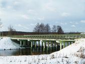 Concrete bridge through small stream — Stock Photo