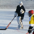 Hockey play of the commands on skating rink outdoors — Stock Photo #8750075