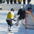 Hockey play of the commands on skating rink outdoors — Stock Photo #8750135