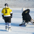 Hockey play of the commands on skating rink outdoors — Stock Photo