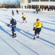 Hockey play of the commands on skating rink outdoors — Stock Photo #9054242