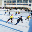 Hockey play of the commands on skating rink outdoors — Stock Photo #9054363