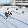 Hockey play of the commands on skating rink outdoors — Stock Photo #9054871