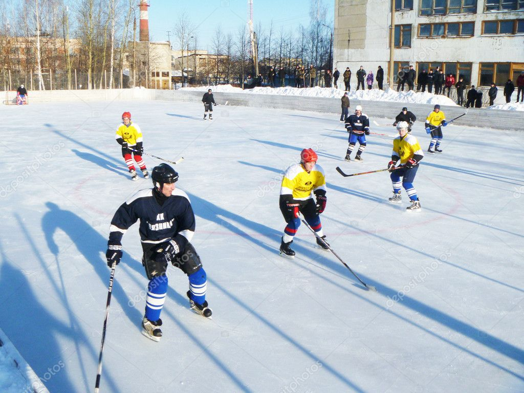 Hockey play of the commands on skating rink outdoors  Stock Photo #9054665