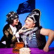 Two fighting pirates on blue — Stock Photo