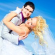 Happy groom and bride on a sea coast - Stock Photo