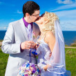 Stock Photo: Happy groom and bride on a sea coast
