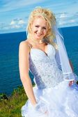 Beautiful bride on a sea coast — Stok fotoğraf