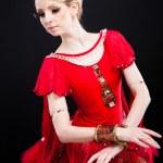 Beautiful ballerina wearing red tutu posing on black — Stock Photo #10343705