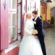 Beautiful groom and the bride on the street of old town — Stock Photo