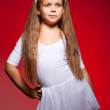 Little ballet dancer isolated on a red background — Foto Stock