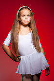 Little ballet dancer isolated on a red background — Stock Photo