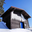 Wooden house in the winter — Stock Photo