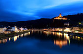 Castle reflected in river at night — Stock Photo