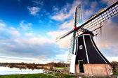 Windmill via wide angle — Stock Photo