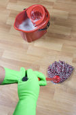 Cleaner mopping floor in office — Stock Photo