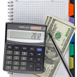 Calculator with a pen in a notebook — Stock Photo