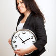 A Confident Woman Holding a Clock — Stock Photo #10067337
