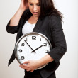 Foto Stock: Young Professional Holding a Clock