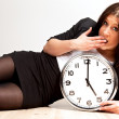 A Tired Woman Holding a Clock — Stock Photo