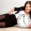 图库照片: A Woman Holding a Clock