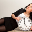 Bored Employee with a Clock — Stock Photo