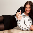 Confident Young Professional with a Clock — Stok fotoğraf